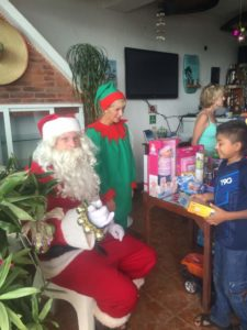 Santa and his elf(Bill and Lois McDonald from Chan Chemuyil) make this a magical event for the children every year